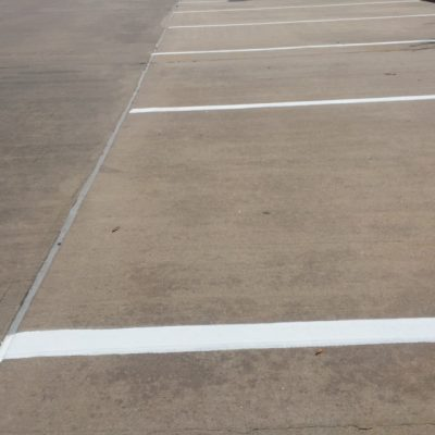 Houston Parking Lot Striping Houston parking lot striping not only enhances the aesthetic value of a property, it also increases public safety. Parking lot striping is required by law for commercial parking lots throughout Houston. Not only does quality line striping put your business in compliance with local laws, it can also help prevent lawsuits for accidents that may occur on your property. Pavement markings should only be applied with professional equipment and high-quality, long lasting paint. Houston parking lot striping and seal coating are considered regular maintenance for parking lots and generally should be applied every two years. We Offer The Following Services: New Layout: Consists of applying fresh paint to a new pattern. If construction plans are not available, we can assist with the parking lot design. Re-Striping: The most efficient way of rejuvenating a parking lot. We can either re-paint the existing layout, or we can completely remove the old lines and paint brand new ones. Sign installation: Parking lot sign certainly compliment lot striping in a variety of ways. Not only do they assist with traffic flow, they are long lasting. Asphalt Crack Repair: Cracks in the asphalt parking lot can be detrimental to the integrity of the surface. They can allow water under the surface, which will erode the foundation. Addressing and repairing cracks these cracks right away can save money in the long run. Car stop bumper removal/ installation: Car stops are an effective way of protecting buildings from parking vehicles. They also help prevent vehicles from blocking a sidewalks with the front or rear-end. Curb/ Car stop painting: Painting curbs are perfect for allocating fire lanes, no parking zone, and even ADA disabled parking areas. HOUSTON ASPHALT PATCHING When an asphalt surface is not properly maintained water infiltration can occur through cracks; this often results pot hole creation. Any top line striping company knows how to handle alligator crackin